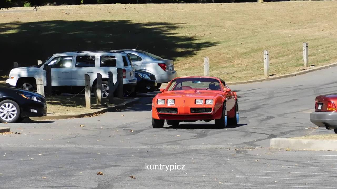 Red oldschool trans am on color match rims burning a lil rubber ...