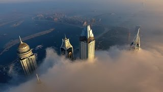 Dubai Marina above the clouds - Aerial footage in 4K