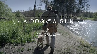 WITH DOG AND GUN