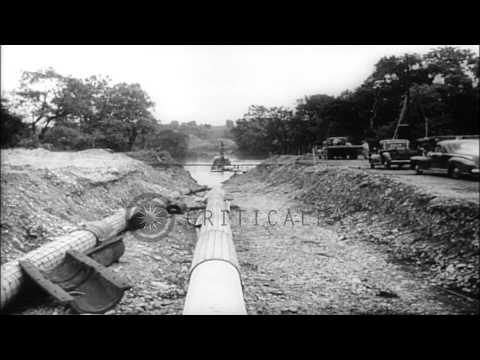 Engineers lay oil pipeline and blast a river making way for the pipeline, United ...HD Stock Footage