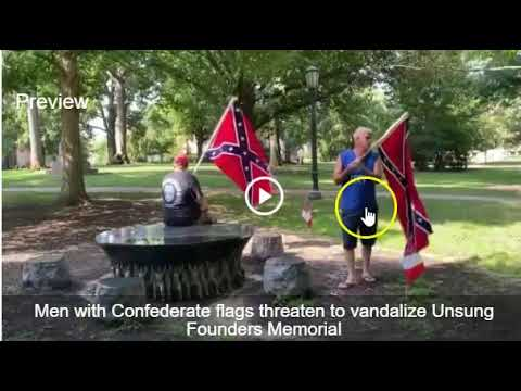 Two Confederate Flag Carrying Parasites Vandalize UNC African American Memorial