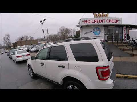 2009 White /Tan Ford Escape XLT 4WD V6 (1FMCU93G59K) with an 3.0L V6 DOHC 24V engine, 4-Speed Automatic transmission, located at 577 Chester Pike, Prospect Park, PA, 19076, (610) 237-1015, 39.886154, -75.302338 - Photo #0