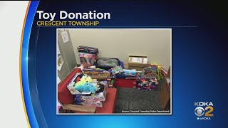 Woman Donates Large Amount Of Toys For Children To Crescent Township Police