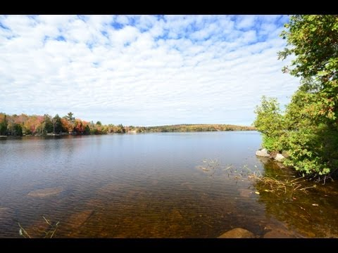 Log Sided Maine Lakefront and Waterfront Cabin and Land For Sale