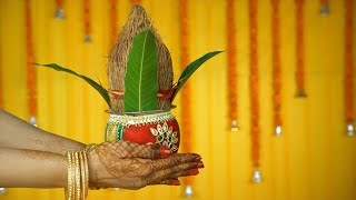 Side view shot of henna mehndi/tattoo on woman hands holding a wedding Kalash. Indian Pooja