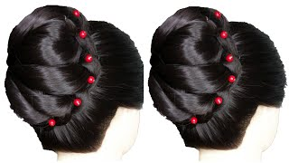 new classic layered french bun hairstyle for ladies
