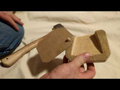 Wood carved axe protector