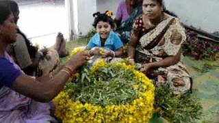bathukamma festival, making bathukamma with all type of flowers, women playing for bathukamma,