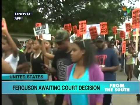 Ferguson awaiting court decision as tension mounts