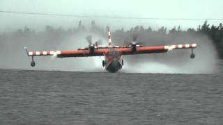 CL-415 Canadair or Bombardier Water Bomber pick up and water drop