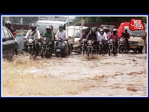 Heavy Rainfall Brings Water Logging And Traffic Jams To Delhi