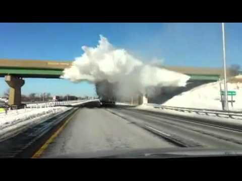 Snow Explodes As Truck Passes Under Bridge (Amazing Footage)