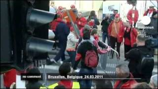 Thousands protest outside EU Brussels summit - no comment