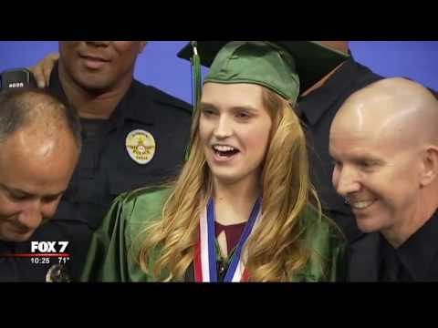 APD officers surprise daughter of fallen officer at Cedar Park High School graduation | 6/2017