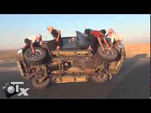 saudis changing tyres while driving