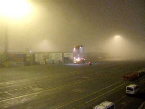 container port  carrier during fog  hamburg