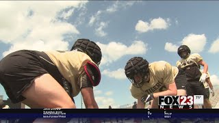 BA football using Guardian Caps to prevent concussions