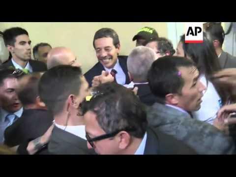 Leftist mayor of Bogota returns to his job after president reinstates him