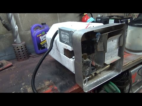 RV water heater dissection. and a sweet concrete machine