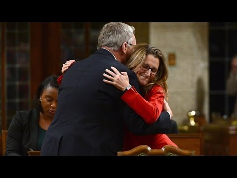 Freeland hugs Conservative MP Ed Fast