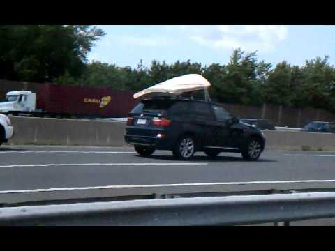 """Mattress flying off of roof of truck"""