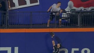COL@NYM: Fan interference nullifies Flores' home run