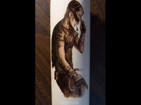 Pyrography of the scout from TF2 on a wooden baseball bat