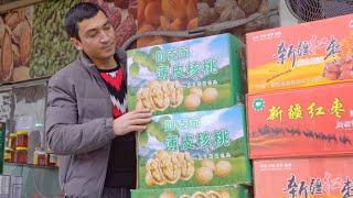 GLOBALink   Xinjiang, My Home: Dried fruit vendor Eili's dream