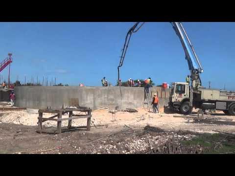 Pre mix truck pouring concrete