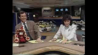 WRAL's Tom Suiter and Adele Arakawa messin' 'round (December 24, 1987)