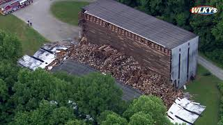 AERIALS: 9,000 aging liquor barrels in pile after building collapse
