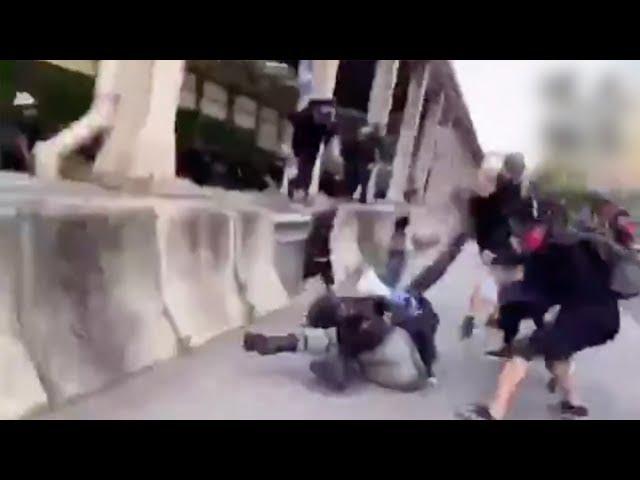 "A Hong Kong police officer is assaulted by armed rioters 香港落單警員被暴徒持械圍毆,這就是妳們說的警察""濫暴""?"
