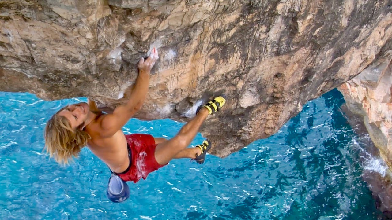 Download Chris Sharma's Most Spectacular Climb! 7 Foot Dyno Over The Ocean