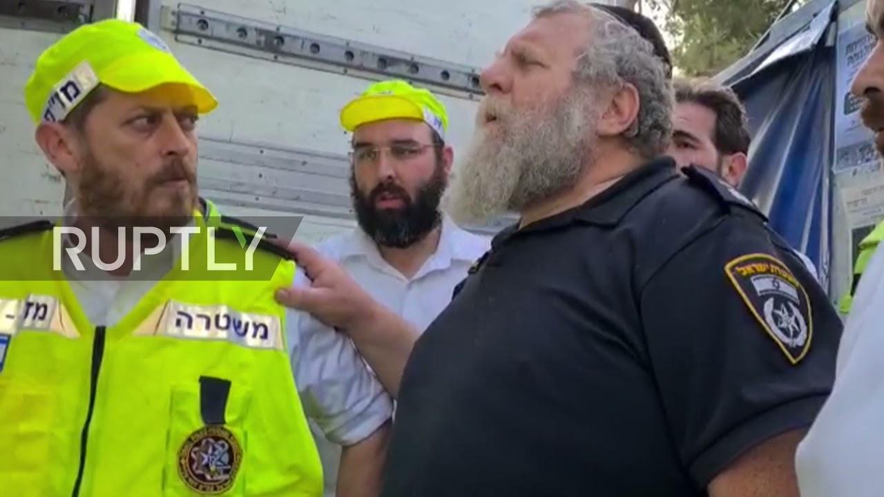 Israel: Volunteer group recites Jewish mourner's prayer next to bodies of Meron victims
