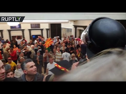 Macedonian MPs under attack as protesters storm parliament building