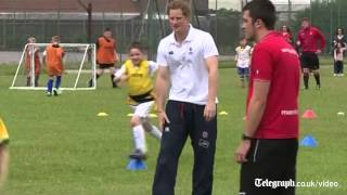 Prince Harry shows off football skills on Suffolk visit