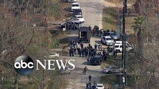 Officers shot in standoff in Houston thumbnail