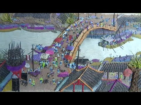 Artisan spends years knitting classical Chinese painting