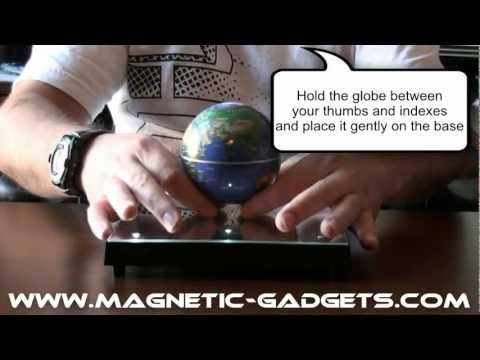 Magnetic globe and floating display on LED mirror base