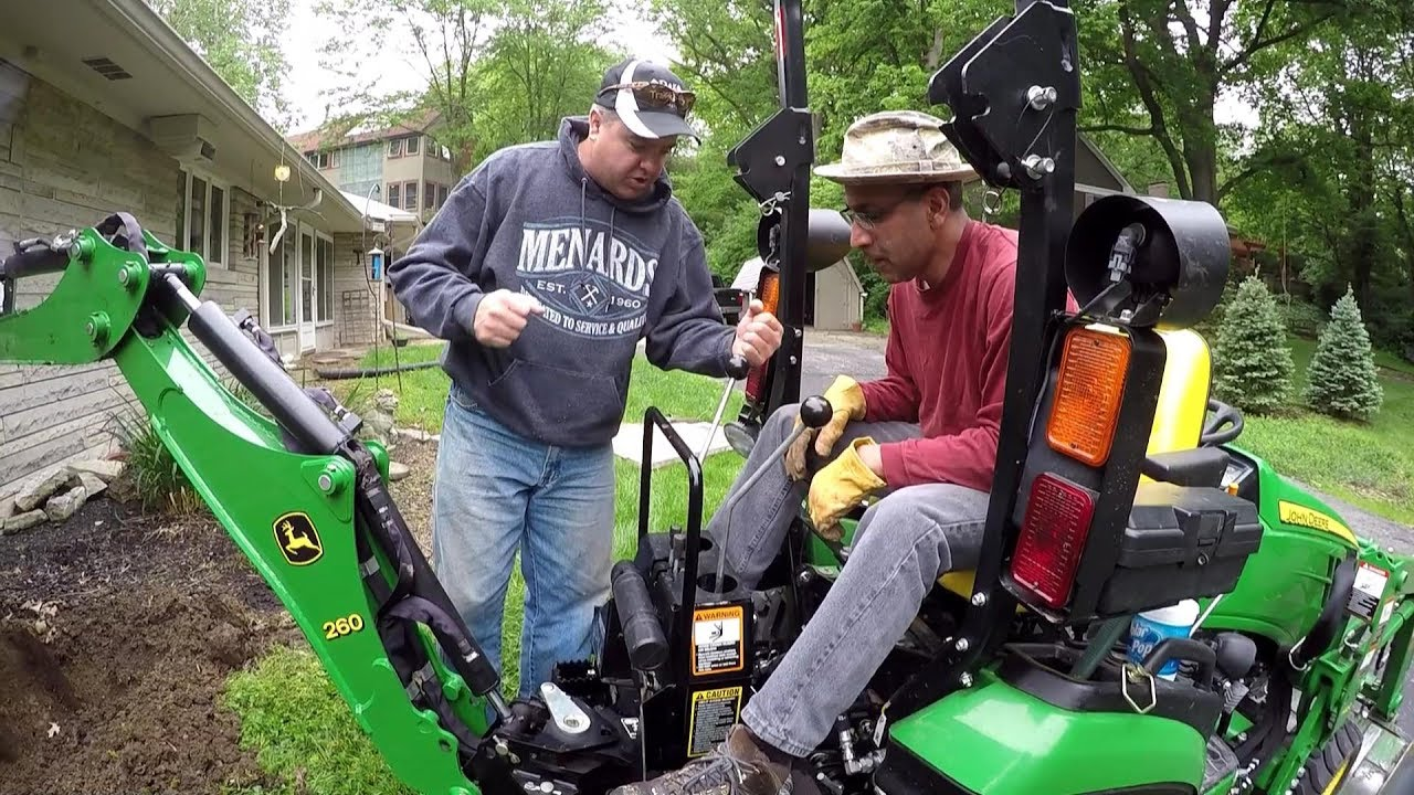 Compact Tractor Backhoe Race Against the Rain