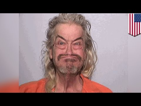 Internet gold: man chases relative with hatchet, takes amazing mugshot upon arrest - TomoNews