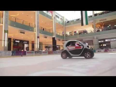 Lotus F1 Team Driving Renault Twizy in The Dubai Mall