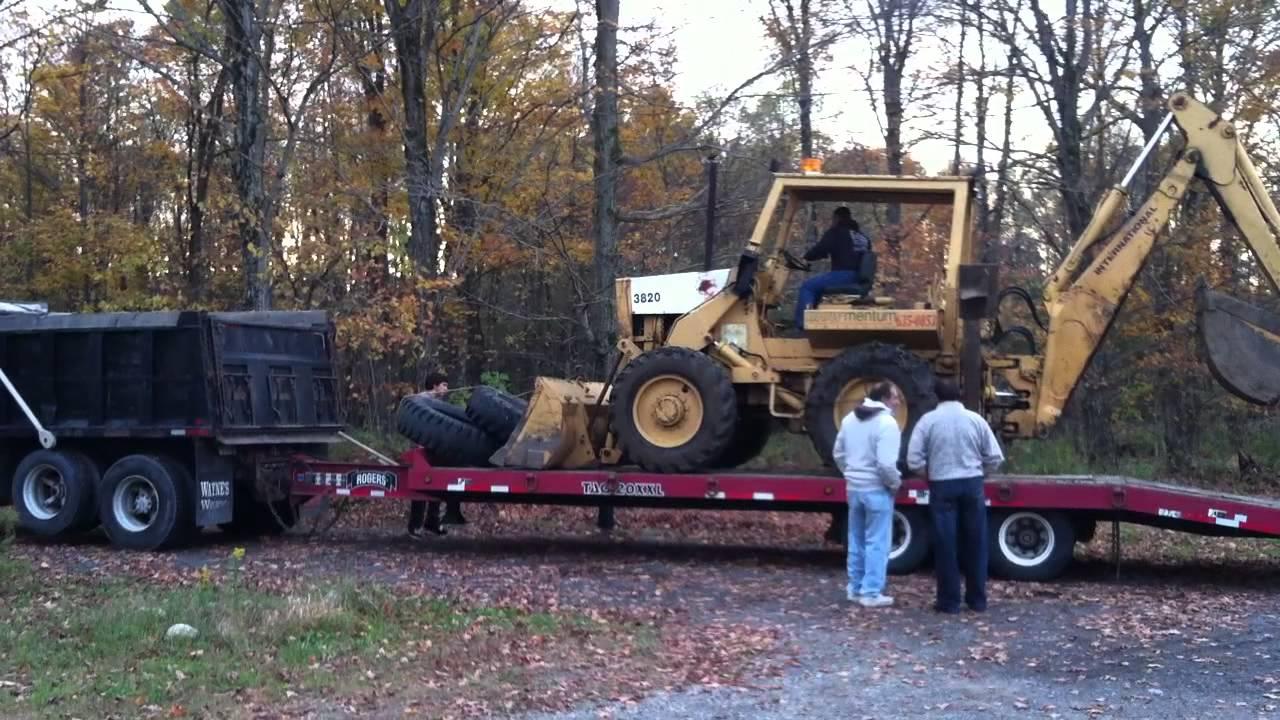 International Harvester Trailers : Sold loading ih a international backhoe
