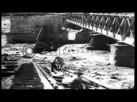 French civilians and US Army engineers repair and salvage railroad yards, bridges...HD Stock Footage