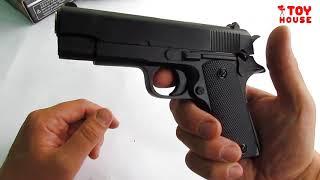 Игрушечный супер пистолет из металла с глушителем и пульками 6мм.Видео обзор для детей.