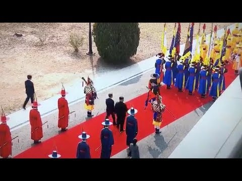 Kim Jong Un and Moon Jae-in walk on the red carpet