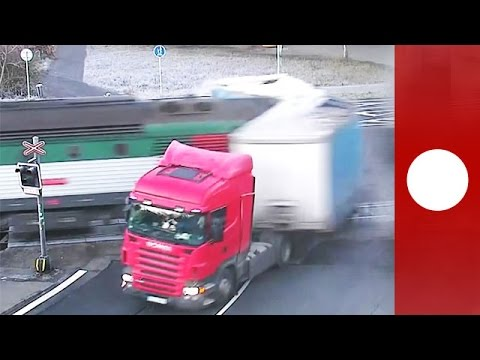 Passenger train smashes into truck at level crossing