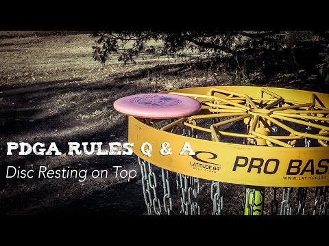 PDGA Disc Golf Rules Q & A | Disc Resting on Top