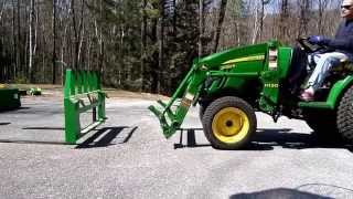 John Deere 2032R Swapping Pallet Forks to Bucket and Back