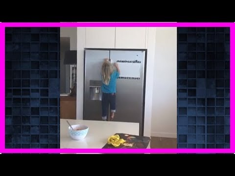 Watch: Chris Hemsworth's 3-year-old son scaled a full-size fridge to get his hands on some sweets
